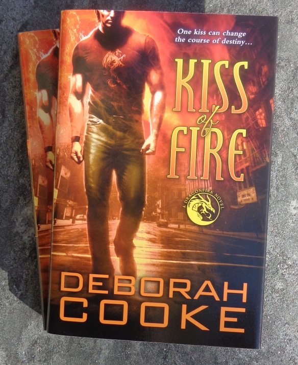 Kiss of Fire, the first book in the Dragonfire series of paranormal romances by Deborah Cooke, in a hardcover collectors' edition