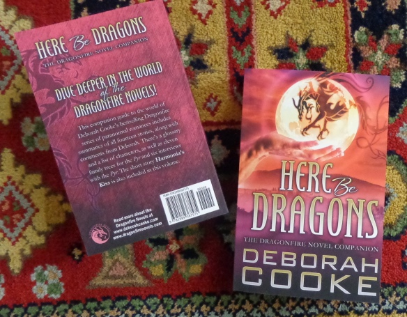 Here Be Dragons: The Dragonfire Novel Companion by Deborah Cooke in trade paperback